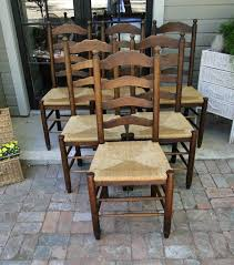 antique french dining chairs made of carved oak with rush seats
