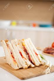Club Sandwich With White Bread On The Kitchen Stock Photo Picture