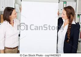 Businesswomen Giving A Flip Chart Presentation