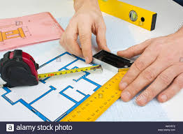 Drawing At Home With Construction Tools On A Background Of