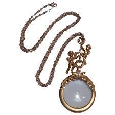 avon angel magnifying glass pendant