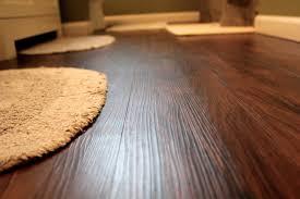 empire oak vinyl plank flooring with interesting beige doormat and baseboard