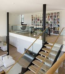 mezzanine office space. obviously my mezzanine loft would be on a much smaller scale but i like the wall off bookshelves helin u0026 co architects have designed villa snow white office space
