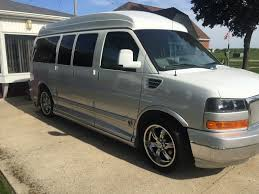 6 passenger plus driver featuring all leather interior seating with 4 captains chairs