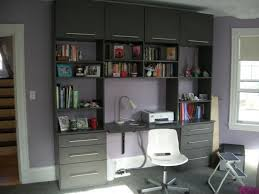 wall unit with storage system desk in the center a modern white chair with wheels bedroom desk unit home