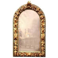 large mid 19th century spanish baroque carved polychrome and gilt wall mirror