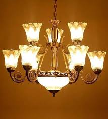 white glass chandelier by aesthetic home solutions