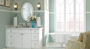 bathroom with white vanity and clawfoot tub