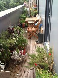 narrow balcony furniture. Narrow Balcony Garden Ideas With Bamboo Deck Floor And Potted Plants Also Wooden Patio Furniture