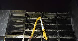 eerie footage shows charred remains of echo arena car park finally being demolished liverpool echo