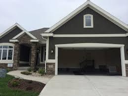 home colors for 2014. dark grey stucco exterior, white trim, nice stone entrance maba parade 2014 · exterior house colorsexterior home colors for