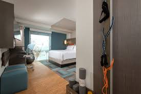 hotel guest room furniture. A King Guest Room At The EVEN Hotels Brooklyn Features Variety Of Fitness Equipment. Photo: InterContinental Group Hotel Furniture