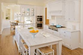 white kitchen with island and seating