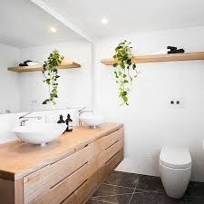 large wooden vanity with lots of drawers in a modern bathroom