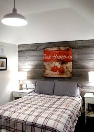 view in gallery farmhouse style bedroom with a modest reclaimed wood feature wall design barnboard