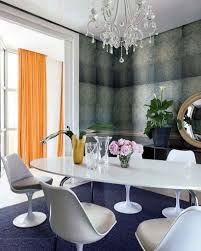 navy blue carpet with modern white dining set and crystal chandelier for impressive dining room decorating idea