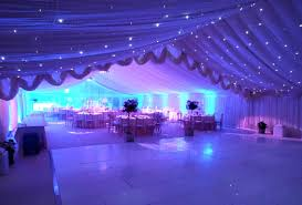 wedding marquee with ivory starlight white dancefloor and purple lights