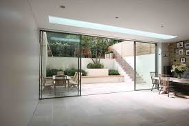 soucie kansas city commercial minimal windows as modern patio in london by iq minimal frameless sliding glass doors exterior windows as modern
