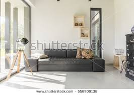 white room with black furniture. white living room with black furniture and window