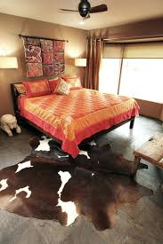 how to hang cowhide rug on wall rug designs inspired coverlet in bedroom eclectic with wall retro velvet wall hangings rugs