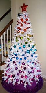 such colorful ornaments look amazing on a crispy white tree and stand out  even more