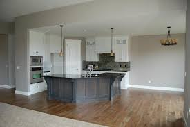 sleek gray countertops feats with curved kitchen island and white wall cabinets large size