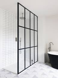a steel frame window wall divides the open shower from the black and