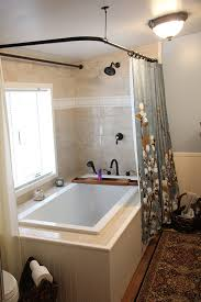 custom shower curtain rod with open top rings so that the curtain can move through the