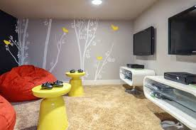 chicago-interior-decorators - A kid's media room in a secret room with  chalkboard