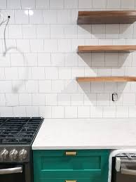 we used white kitchen caulk to match the ceramic tile backsplash you could also use a clear caulk just to finish everything off