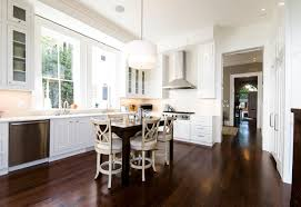 kitchens with white cabinets and dark floors. Example Of A Classic Brown Floor Kitchen Design In DC Metro With  Glass-front Cabinets Kitchens White And Dark Floors B