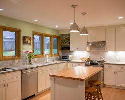 this kitchen remodel was made spacious by combining the kitchen and dinette to accommodate a busy