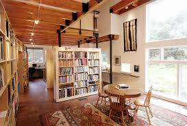 library mountain style home office photo in boston with concrete floors bookcases for home office