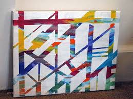 this diy abstract painting was created using painters tape over a very loud and brash painted canvas