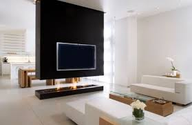 By keeping the suspended room divider wider than the fire pit below, the TV  on the wall is not subject to the rising heat of the flames.