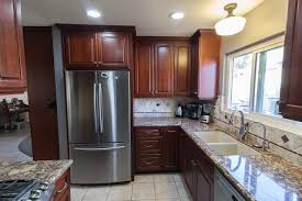 Dynasty Omega Kitchen Cabinets Dynasty By Omega Cabinetry In Brookside Arch Door Style Cherry