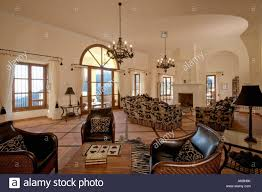 Terracotta Living Room Leather Armchairs And Terracotta Tiled Floor In Large Living Room