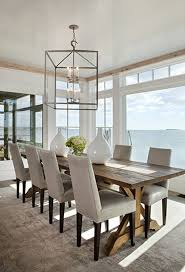 water front home is designed by micheal greenberg and associates the light fixture is a perfect example of using an oversized fixture above your table