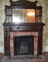 beautiful tile set and fireplace front carved solid wood mantel from 1890 victorian house