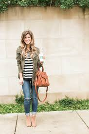 cute fall outfit idea how to wear a green military jacket styled with black and