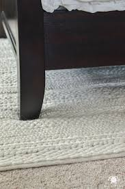 rug under bed hardwood floor. Why Rugs Should Be Layered On Carpet- Chunky Knit Wool Rug Under Bed #RugsOnCarpet Hardwood Floor U