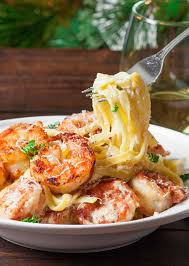 crispy cajun shrimp fettuccine with homemade creamy sauce and jumbo shrimp that are coated in a