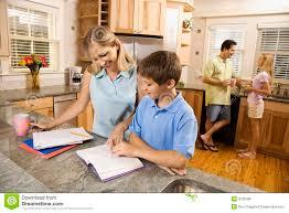 Family Kitchen Family In Kitchen Doing Homework Royalty Free Stock Photos