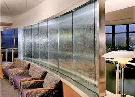 Indoor waterfall. See More. Rock staircase with water feature