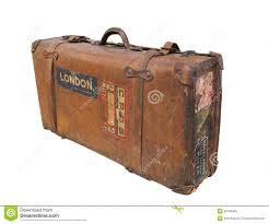 Vintage leather suitcase with straps isolated.