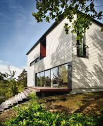 The modern city villa is located in North Helsinki, in an area  characterized by old wooden villas. The sculptural form is motivated by the  dramatic setting: ...
