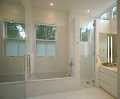 tiny shower stall transitional bathroom and clean lines flush cabinets glass shower door mirror recessed lights shower enclosure soaking tub specialty glass