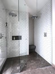 Alcove shower - contemporary white tile and subway tile alcove shower idea  in London with white