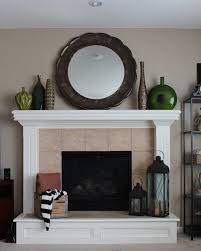 this fireplace makeover included new ceramic tiles and a wooden hearth