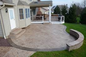 stained concrete patio. Exterior. Grey Stained Concrete Patio Floor With Stone Bench And Green  Grass Yard Also Stained Concrete Patio